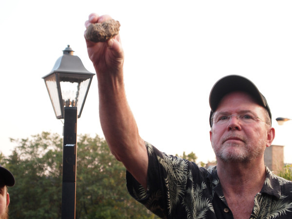 Great Lakes Brewing Founder and University Of Chicago Graduate Pat Conway showcasing Bappir ( a twice baked Sumerian barley bread) used in making the 3 Sumerian Beers
