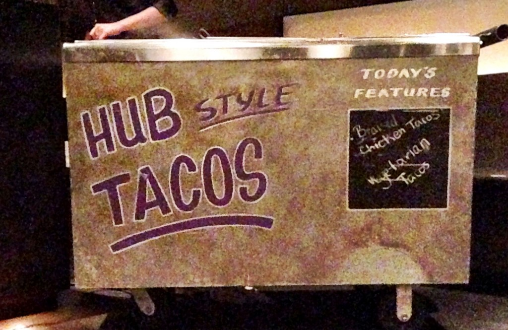 sushi apps , mini sandwiches, desserts and the Hub tacos station were the menu items